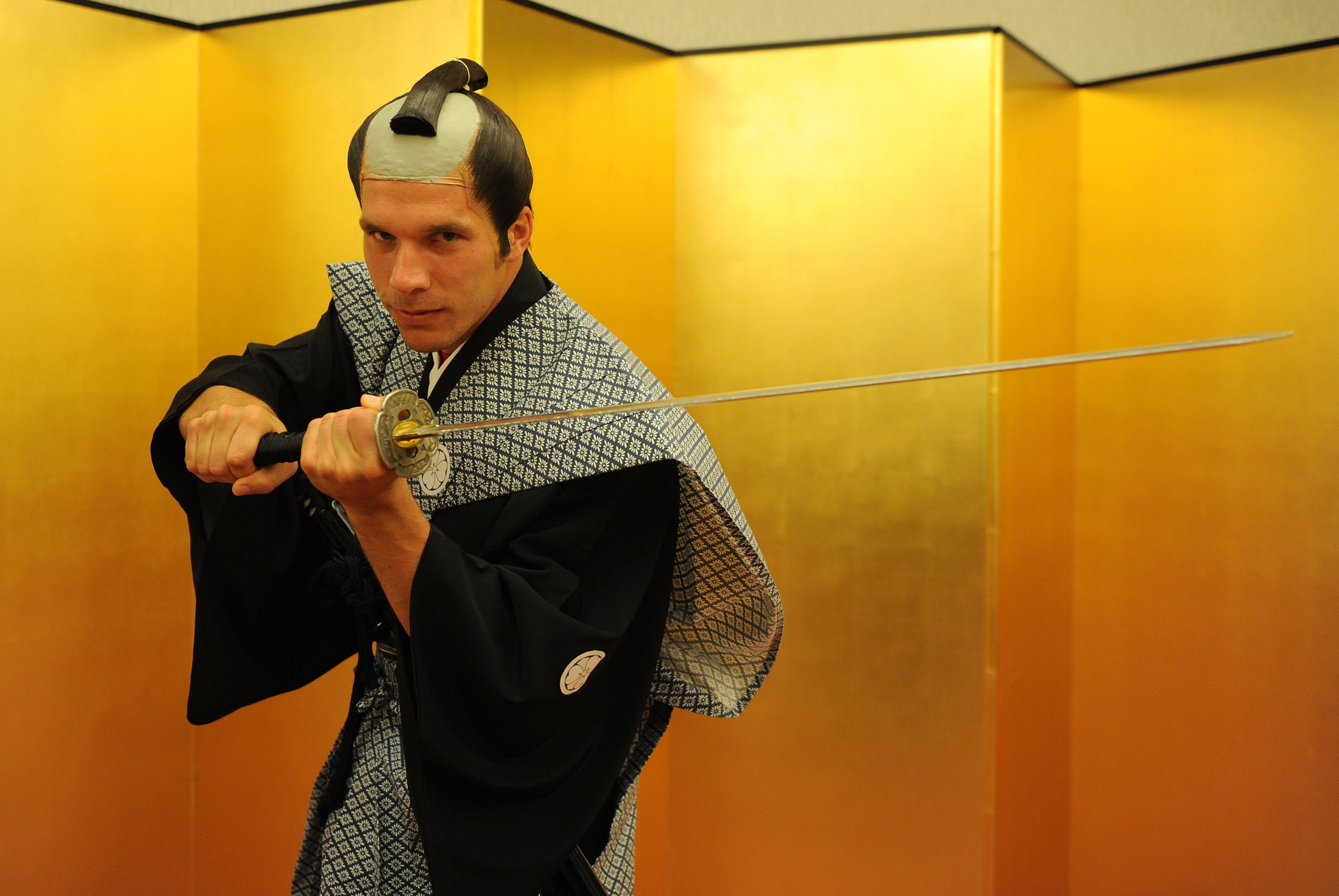 SAITAMA, JAPAN - JULY 25: (EXCLUSIVE COVERAGE) Lukas Podolski of Arsenal FC poses dressed as a Samurai Warrior in the Urawa Royal Pines Hotel in Japan for the club's pre-season Asian tour on July 25, 2013 in Saitama, Japan. (Photo by David Price/Arsenal FC via Getty Images)